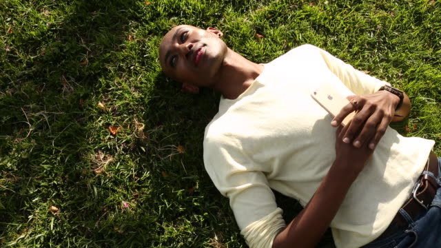portrait of a young gay men outdoors on a sunny day. - reclining stock videos & royalty-free footage