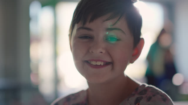 portrait of a young girl smiling at the camera in an ice cream parlor - short hair stock videos & royalty-free footage