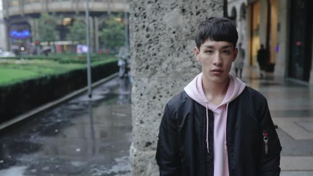 portrait of a young handsome asian man - scienza e tecnologia video stock e b–roll