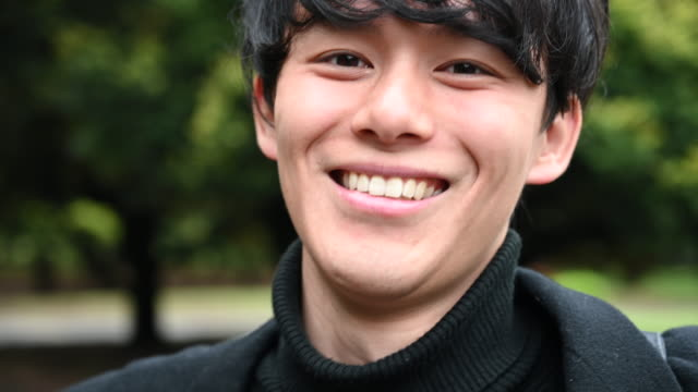 portrait of a young japanese man smiling - japanese ethnicity stock videos & royalty-free footage