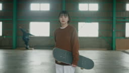 Portrait of a young Japanese skateboarder