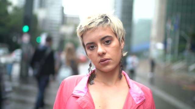 portrait of a young latin woman in the city - short hair stock videos & royalty-free footage