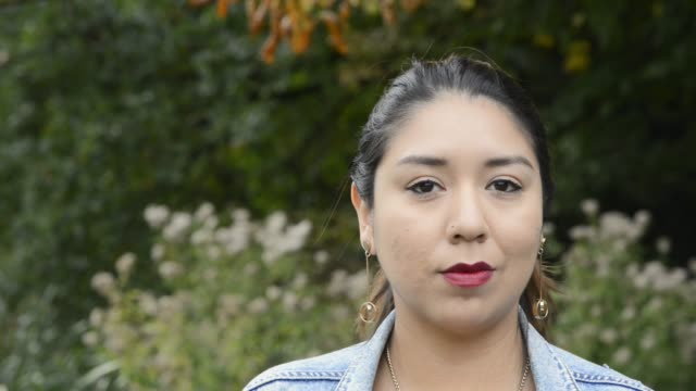 portrait of a young latin woman looking at camera - indigenous peoples of the americas stock videos & royalty-free footage