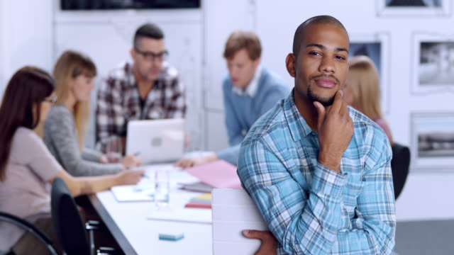 portrait of a young male in business startup office - goatee stock videos & royalty-free footage
