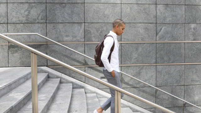 portrait of a young man commuting to work - steps and staircases stock videos & royalty-free footage