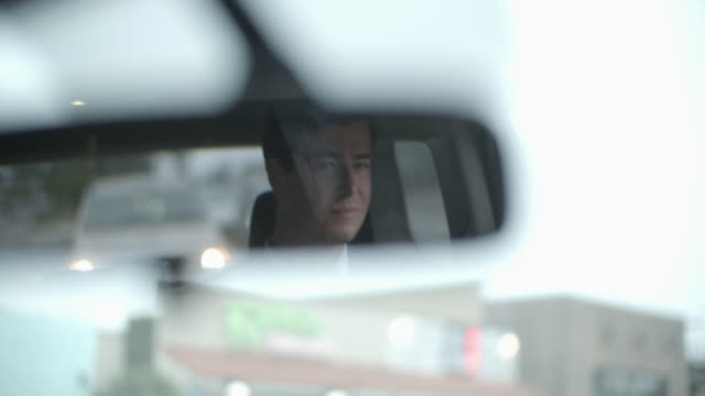ms portrait of a young man in the rearview mirror - full suit stock videos & royalty-free footage