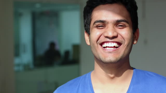 portrait of a young man smiling - indian ethnicity stock videos and b-roll footage