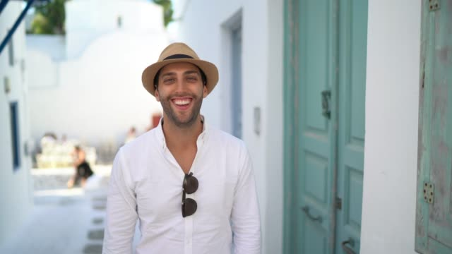 portrait of a young man standing in the streets of mykonos - mykonos stock videos & royalty-free footage