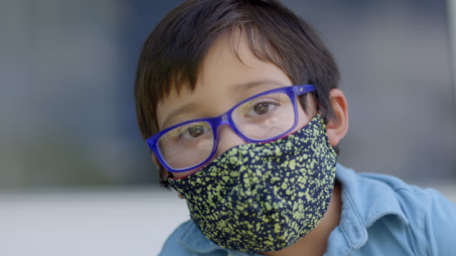 slo mo cu portrait of a young native-american boy wearing a protective face mask - veranda stock videos & royalty-free footage