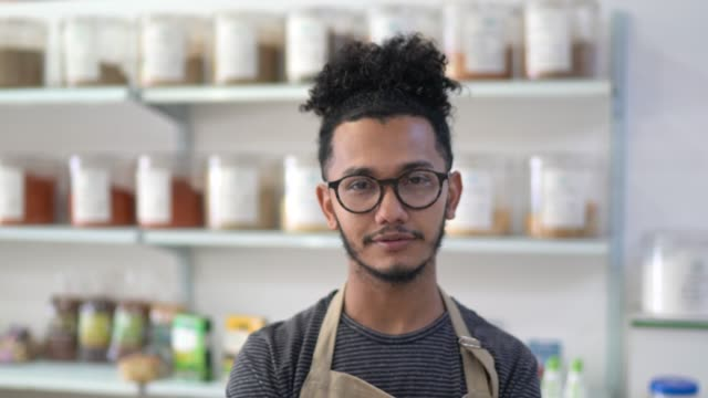portrait of a young seller standing in a natural products shop - pardo brazilian stock videos & royalty-free footage