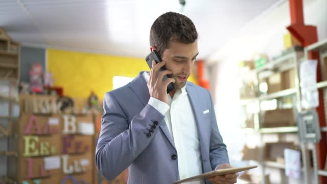 portrait of a young small business owner talking in the phone - pardo brazilian stock videos & royalty-free footage