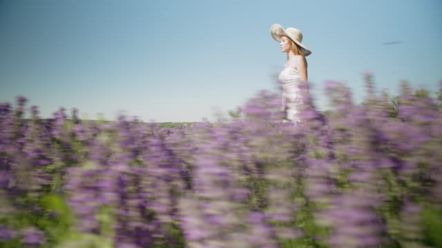 portrait of a young smiling teenager dressed in white in the middle of the blooming lavender fields. wanderlust. - eco tourism stock videos & royalty-free footage