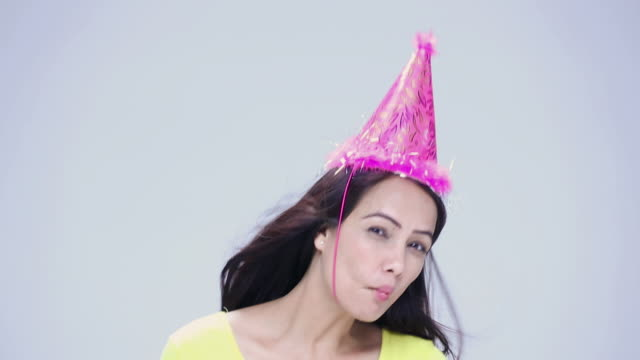portrait of a young woman celebrating birthday  - party hat stock videos and b-roll footage