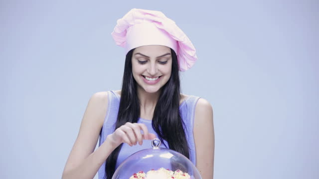 portrait of a young woman cooking a cake - chef's hat stock videos & royalty-free footage