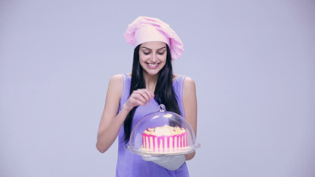portrait of a young woman cooking a cake - temptation stock videos & royalty-free footage