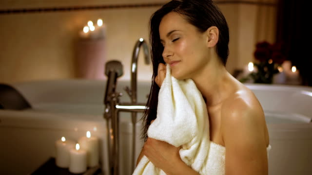 hd: portrait of a young woman in the bathroom - towel stock videos and b-roll footage