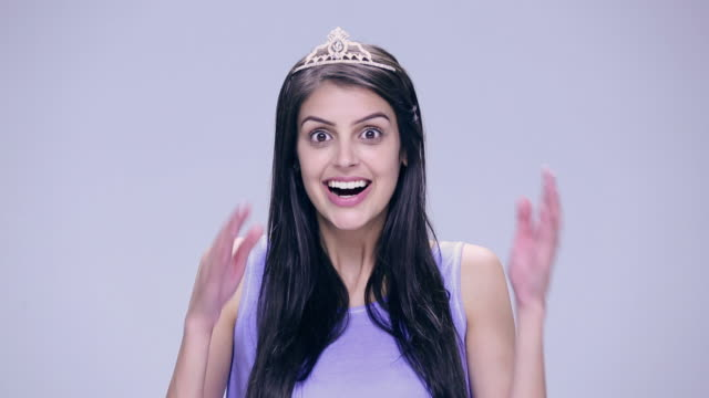 portrait of a young woman pretending as a princess - crown headwear stock videos and b-roll footage