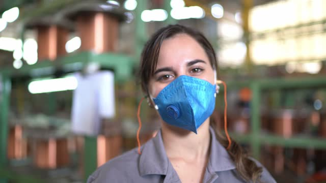 portrait of a young woman standing in a factory - production line worker stock videos & royalty-free footage