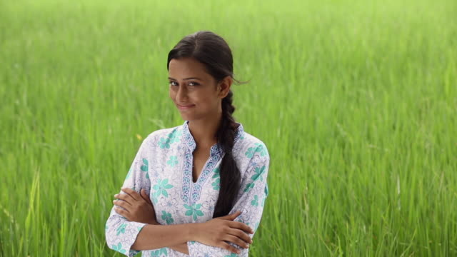 Portrait of a young woman standing in the farm, Haryana, India