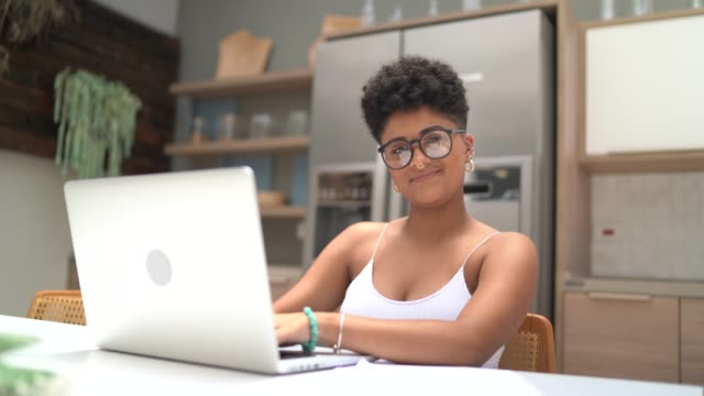 portrait of a young woman using laptop at home - latin american and hispanic ethnicity stock videos & royalty-free footage