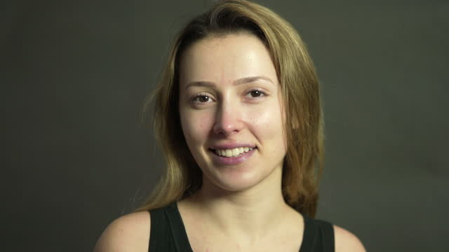 a portrait of a young woman wearing no make-up - no make up stock videos & royalty-free footage