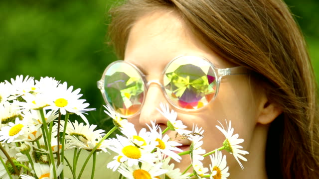 portrait of a young woman with a bouquet of daisies in a shiny sunglasses - bouquet stock videos & royalty-free footage