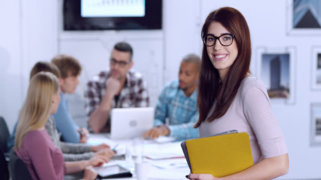 Portrait of a young woman with glasses in business startup office