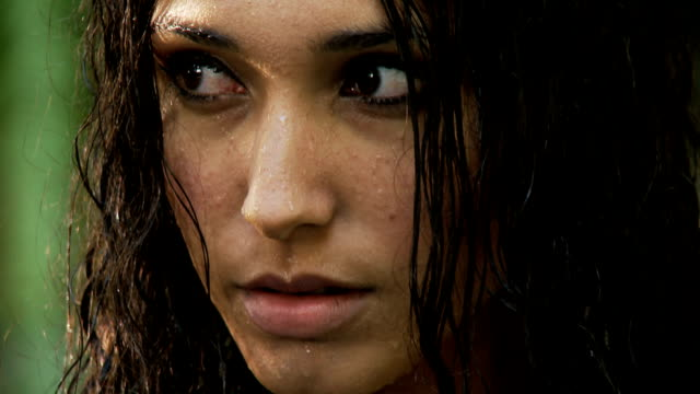 Portrait of a young woman with wet hair