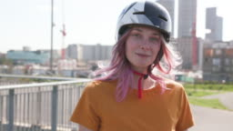 Portrait of a young women BMX rider looking to camera