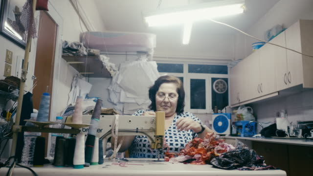 portrait of active female senior using sewing machine - greek culture stock videos & royalty-free footage