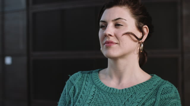 portrait of adult female in city - hoop earring stock videos and b-roll footage