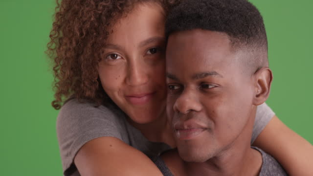 portrait of african american man and woman embracing each other on green screen - other点の映像素材/bロール