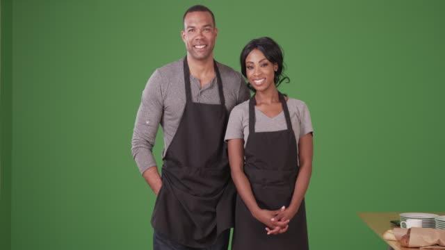 vidéos et rushes de portrait of african american man and woman small business owners on green screen - société de consommation