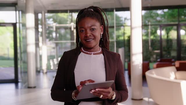portrait of african businesswoman using digital tablet in office - formal businesswear stock videos & royalty-free footage