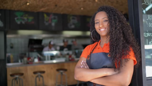 portrait of african ethnicity waitress / owner at restaurant - small stock videos & royalty-free footage
