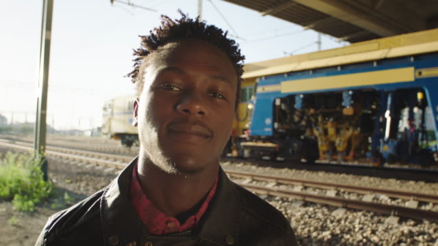 portrait of african man standing on the railroad truck. - eyes closed stock videos and b-roll footage