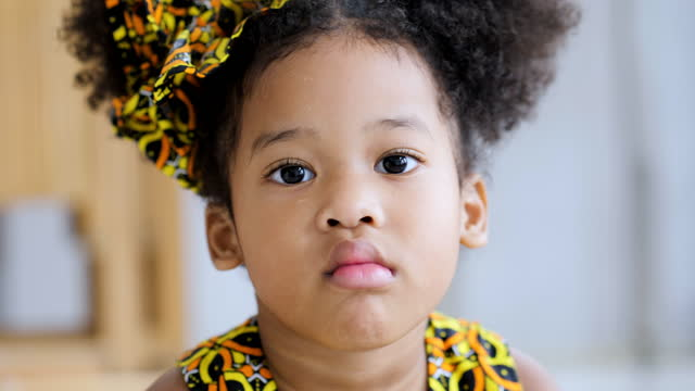 portrait of african small girl at home. - disgust stock videos & royalty-free footage