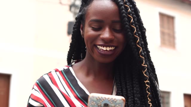 portrait of african woman using mobile phone at street - pardo brazilian stock videos & royalty-free footage