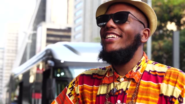 portrait of afro descent smiling and playing guitar on avenida paulista, sao paulo, brazil - beard stock videos & royalty-free footage