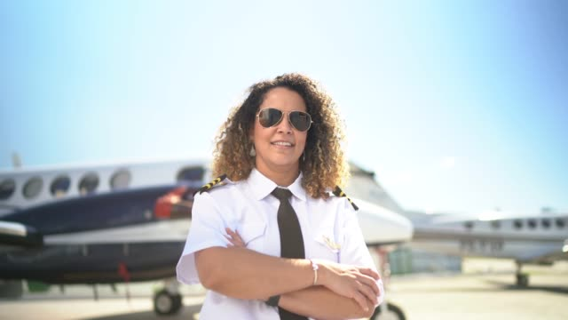 portrait of airplane pilot in front of a private jet and looking at camera - 45 49 years stock videos & royalty-free footage