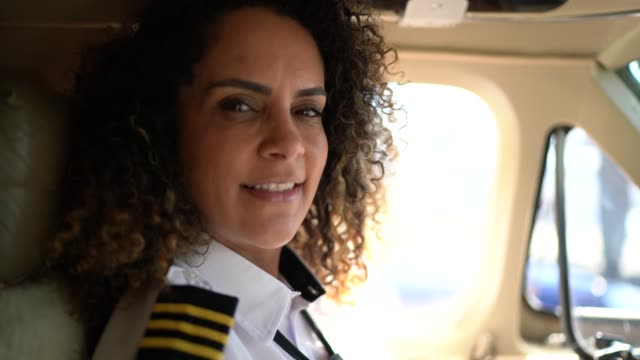 portrait of airplane pilot looking at camera in a private jet - 45 49 years stock videos & royalty-free footage