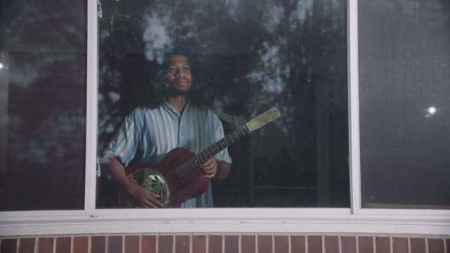 portrait of an adult african-american man with his guitar - only mid adult men stock videos & royalty-free footage