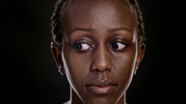 portrait of an african-american female moving her eyes - looking around stock videos & royalty-free footage