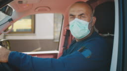 SLO MO Portrait of an ambulance driver putting on a medical mask