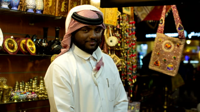 portrait of an arab businessman in his traditional costume in his gift shop in the arab market in doha, qatar. - souk stock videos & royalty-free footage