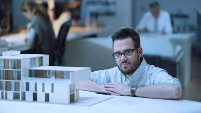 DS Portrait of an architect by his architectural model