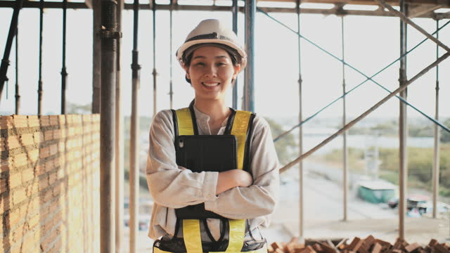 portrait of an architect or builder in hard hat standing in front of building under construction - adult stock videos & royalty-free footage