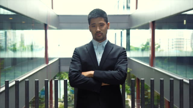 portrait of an asian businessman (slow motion) - front view stock videos & royalty-free footage