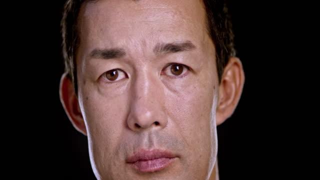 vídeos y material grabado en eventos de stock de retrato de un hombre asiático - veinte segundos o más