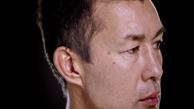 portrait of an asian man looking with anger and resentment - head stock videos & royalty-free footage